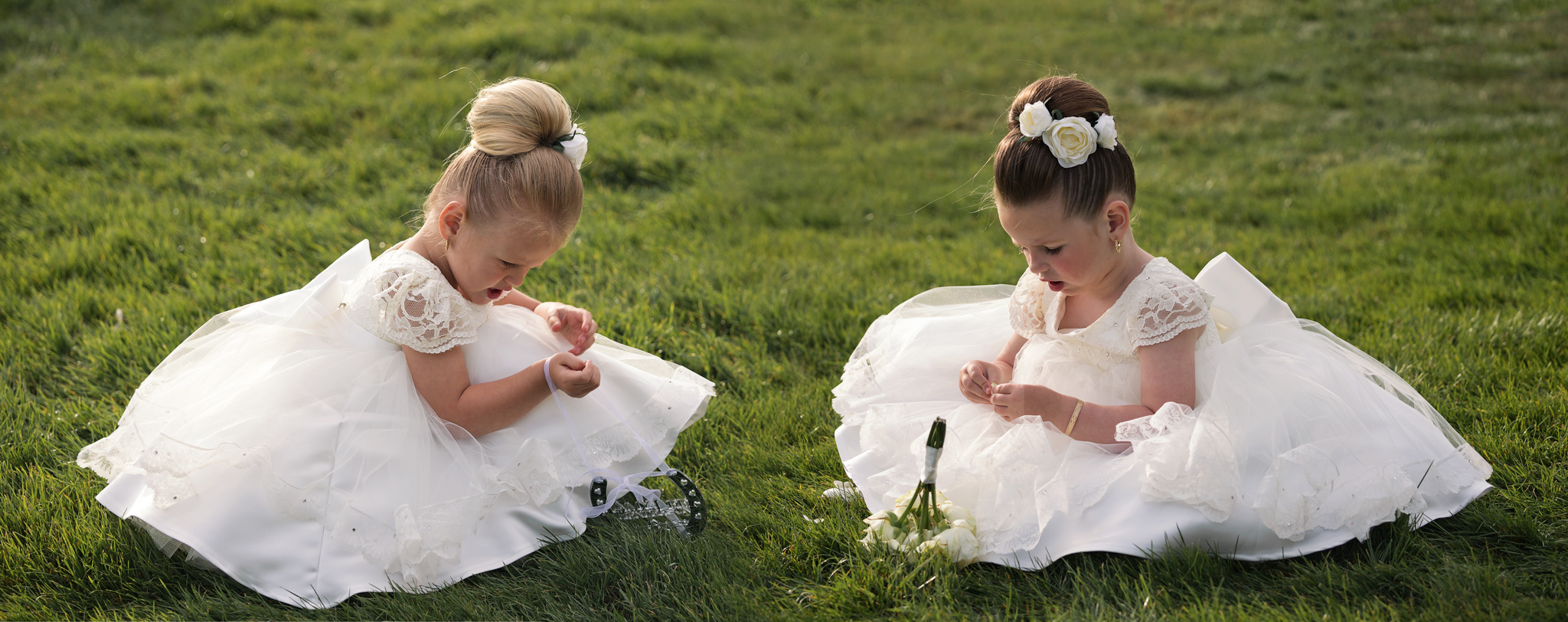 Two little flower girls resting